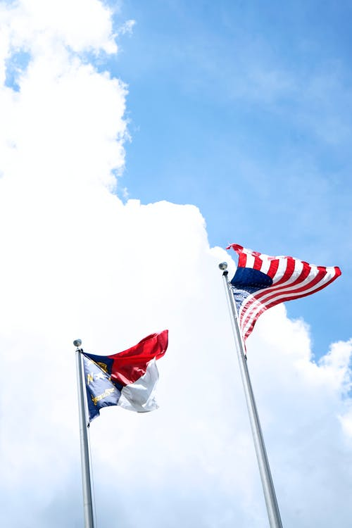 Low Angle Photo of Flag of the United States of America Under Blue Sky