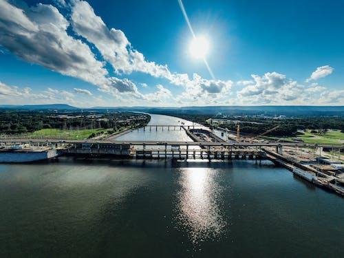 Aerial Photo of Bridge Under Blue Sky During Daytime