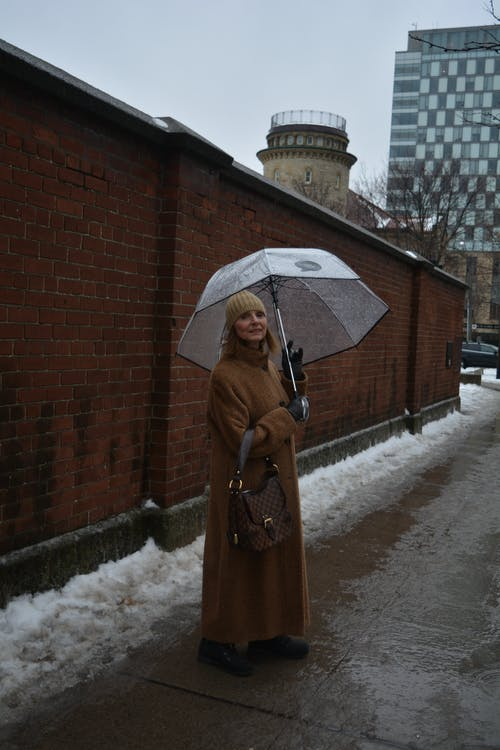 Photo of a Woman Carrying Umbrella
