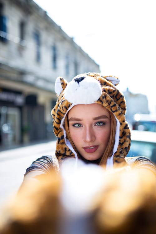 Photo of a Woman Wearing Tiger Hoodie