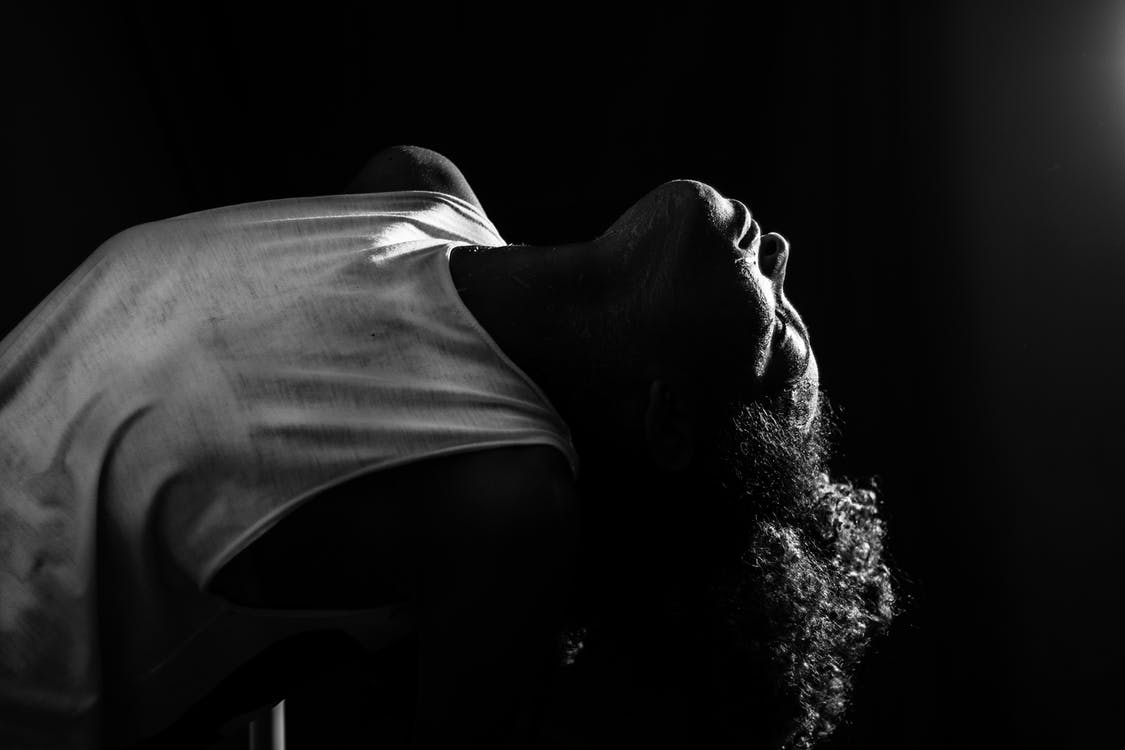 African American woman performing in darkness