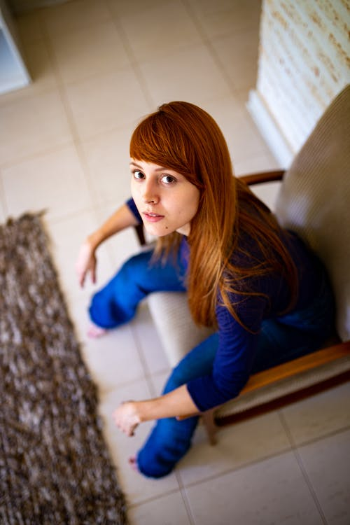 High-Angle Photo of Woman Sitting on Chair