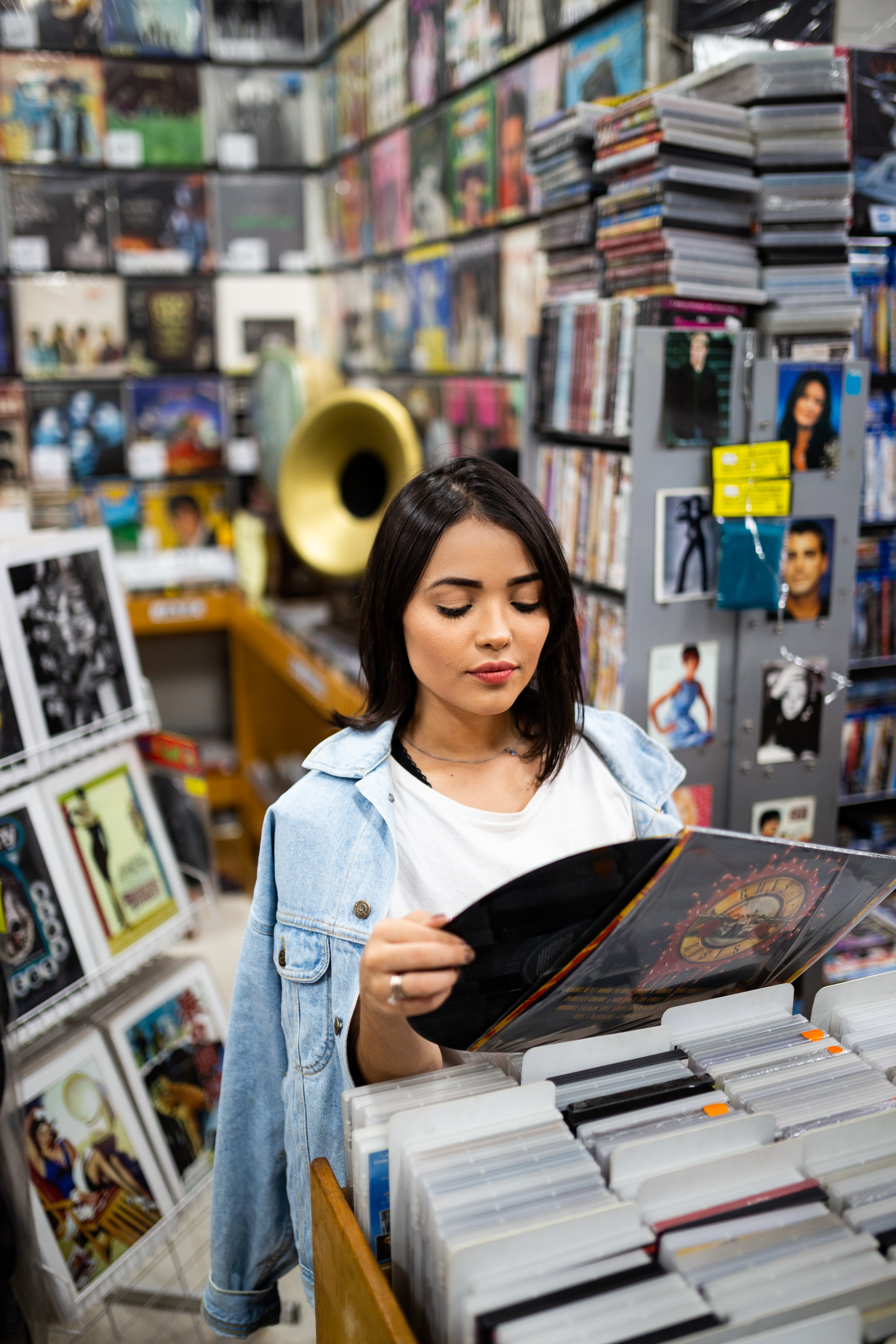 Photo of Woman Holding Phonograph Record