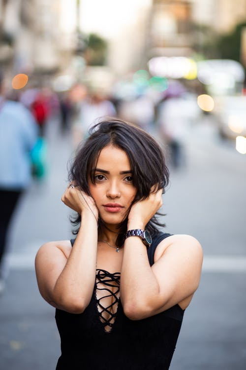Photo of Woman Holding Her Hair