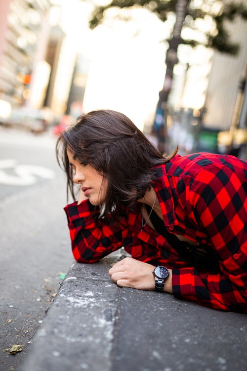 Photo of Woman Wearing Red Plaid Shirt