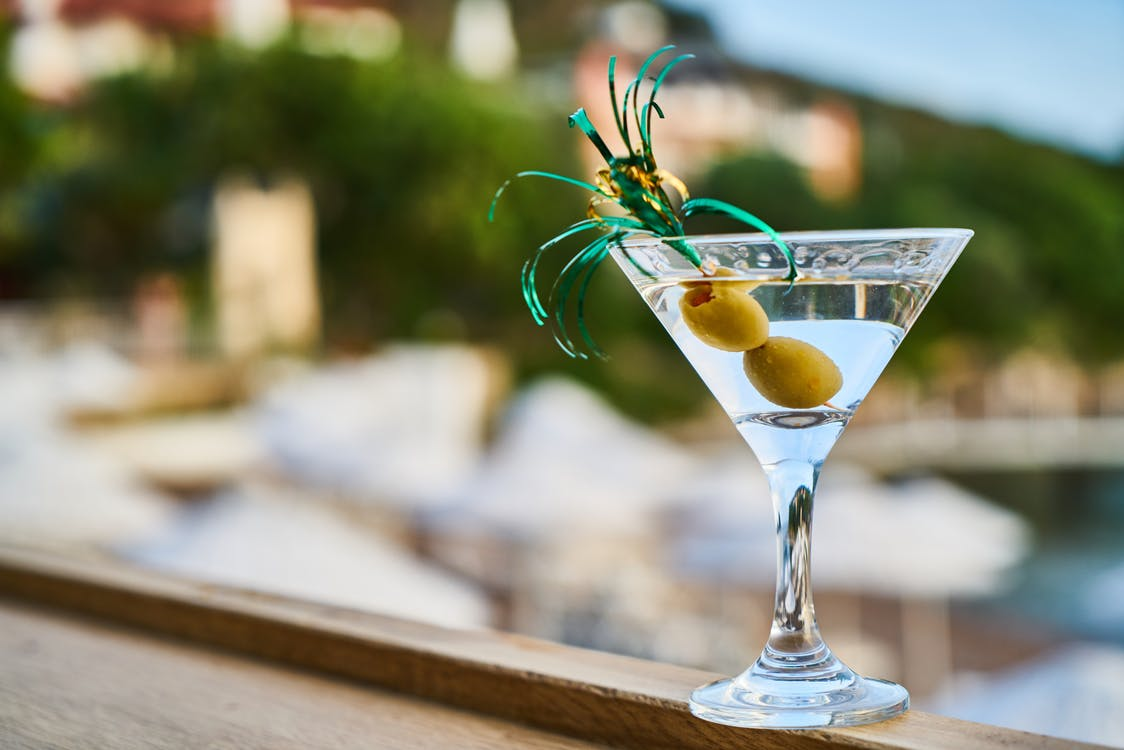 Close-Up Photo of Martini With Olives