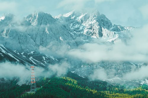 Photo of Snow Capped Mountain Covered by Fog