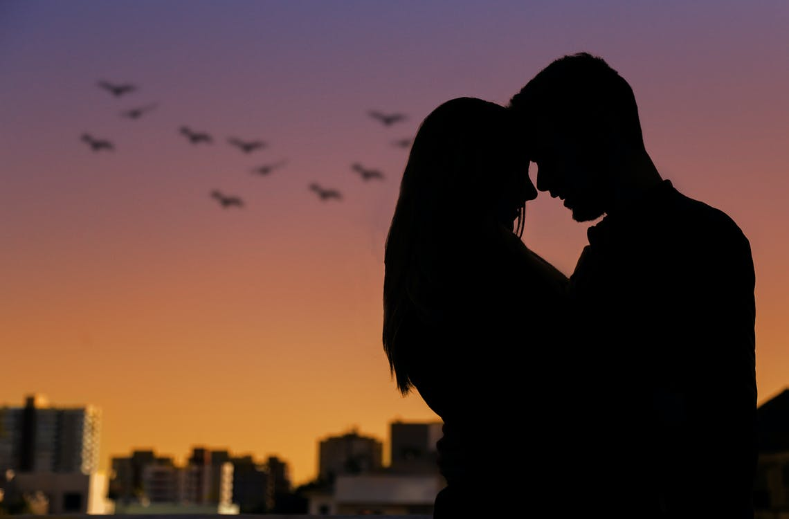Silhouette Photo of Couple During Golden Hour