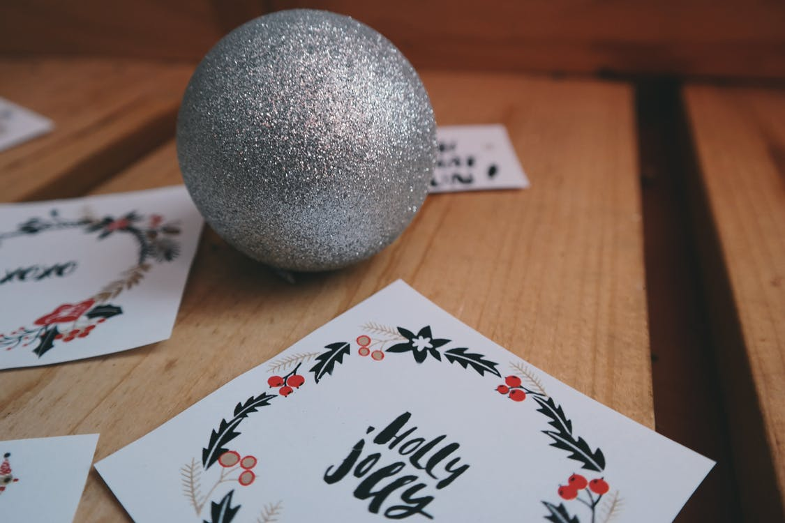 cards and a bauble on a table