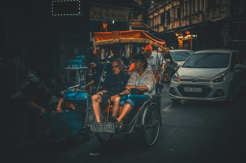 Photo of a Man and Woman Riding Carriage