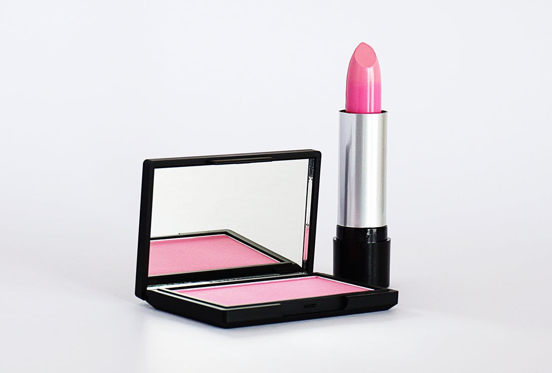 Close-Up Photo of Pink Lipstick and Blush-On