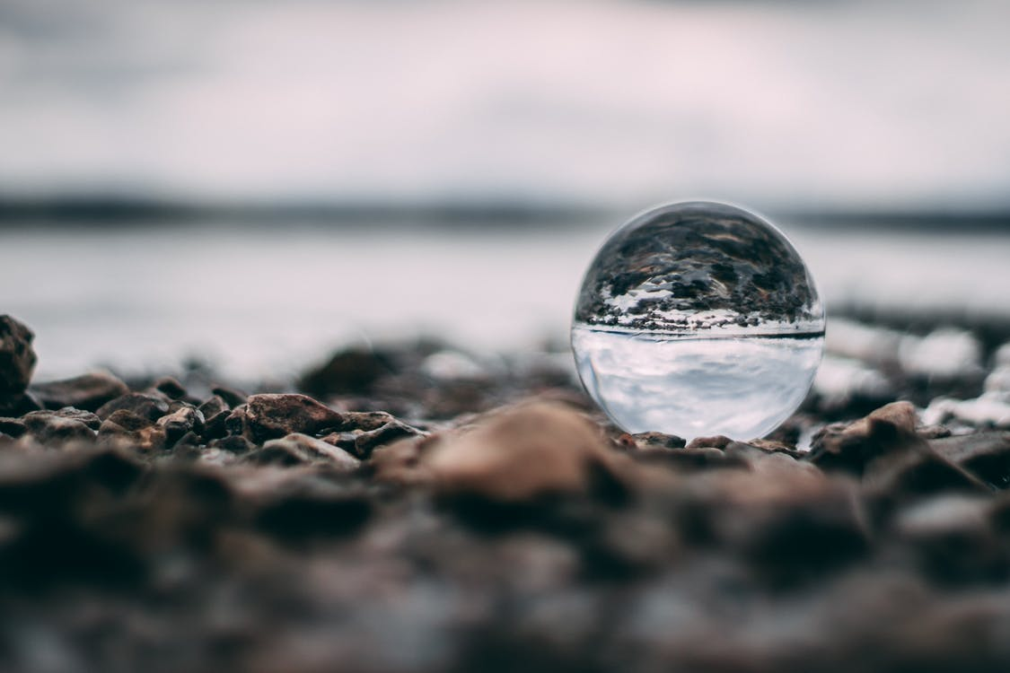 Close-Up Photo of Lensball on Ground