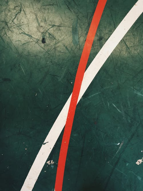 Green Surface With White and Red Linage Close-up Photography