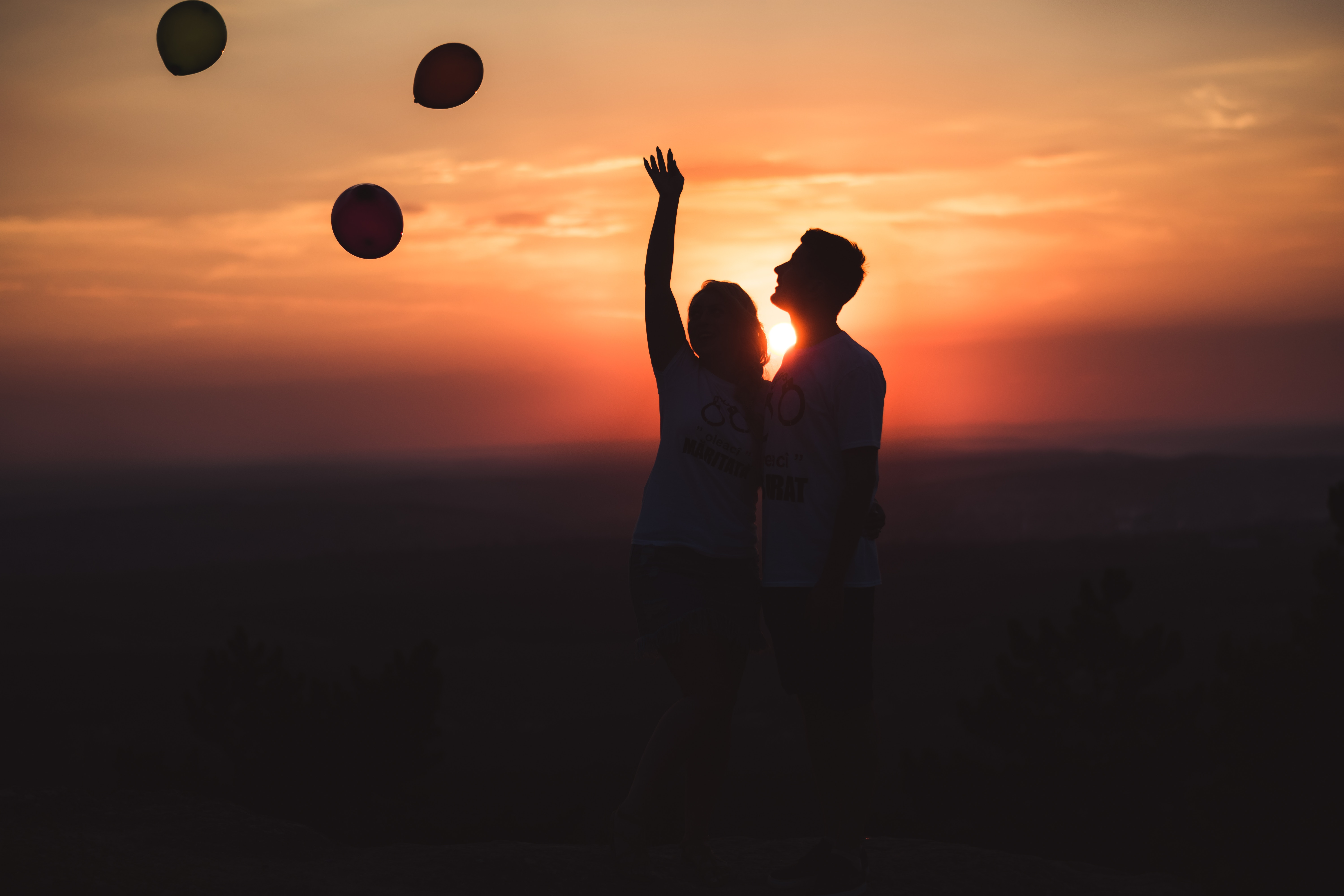 Silhouette Photo of Couple Standing Outdoors