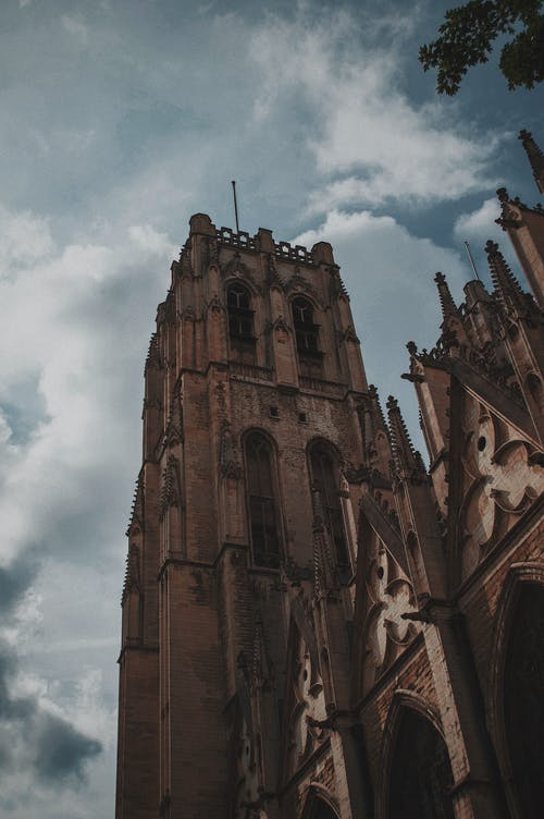 Low-Angle Photo of Church Under Cloudy Sky