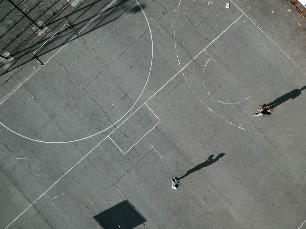 Top View Photo of People Playing Basketball