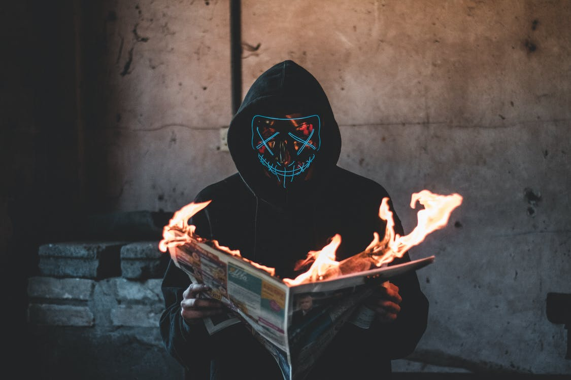 Person Holding a Burning News Paper Close-up Photography