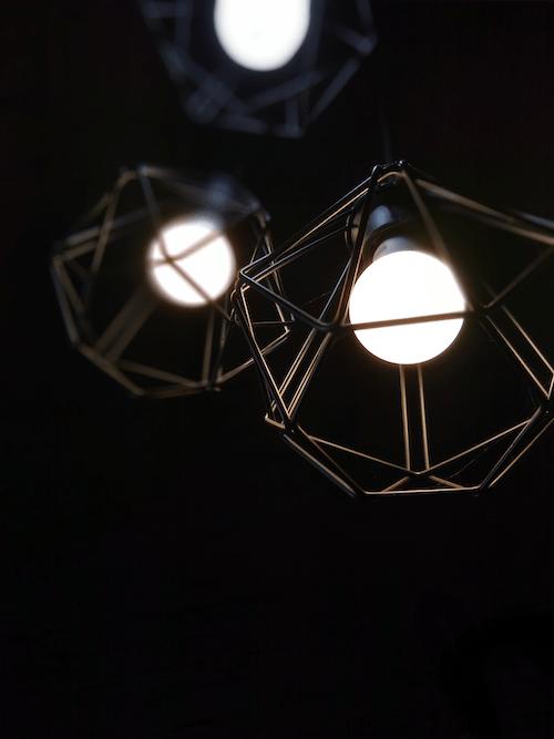 Turned on Black Metal Framed Light Bulbs