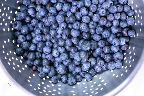 Close-Up Photo of Blueberries in Strainer