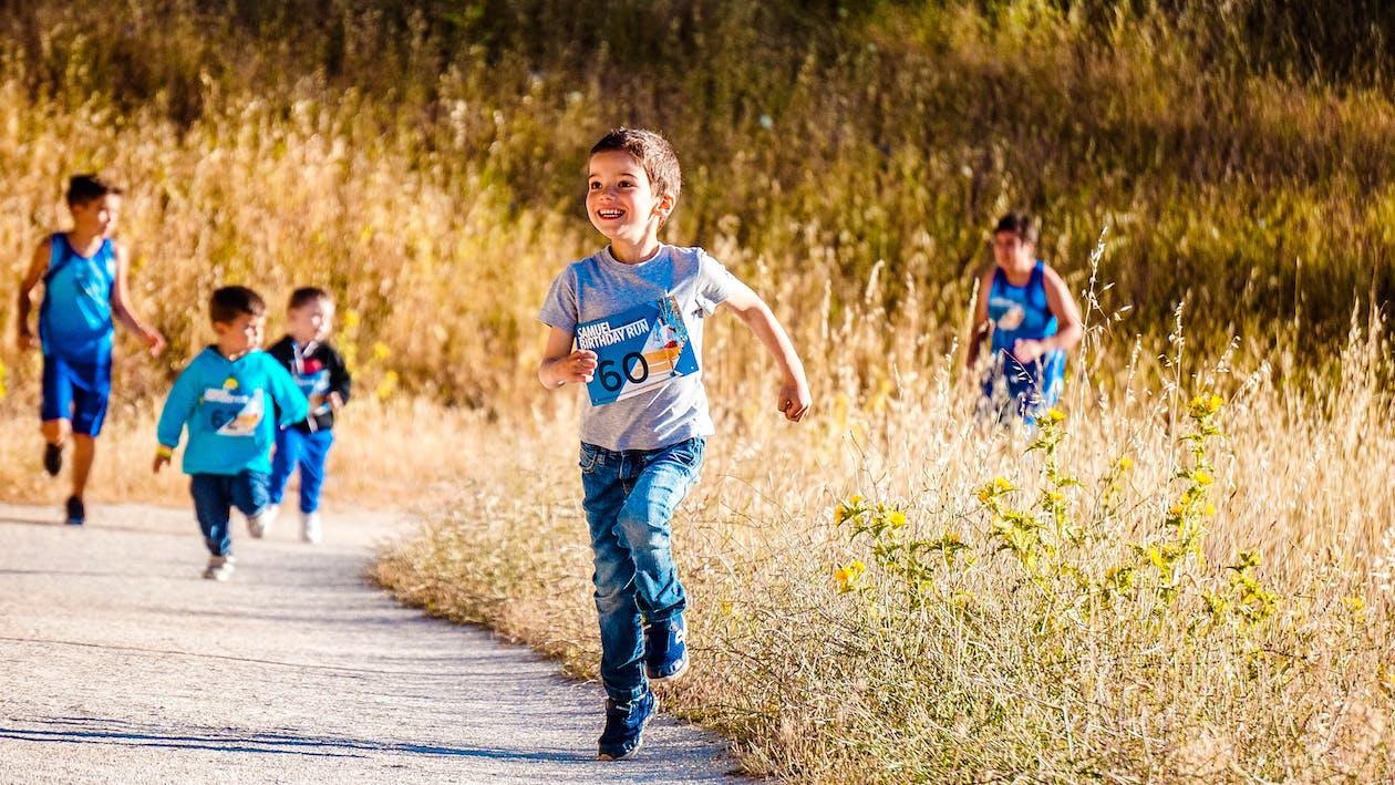 Boy Running on Pathway