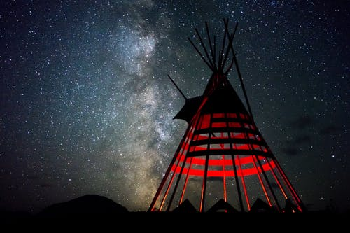 Red and Black Indian Hut Under Star Sky