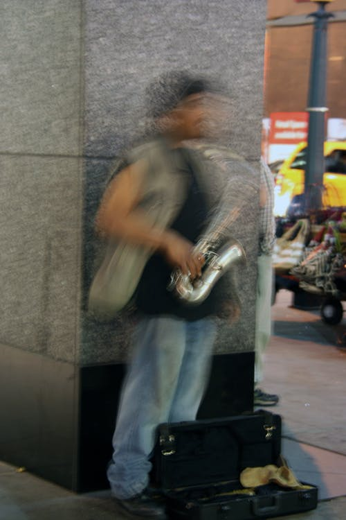 Blurred Motion of Man Playing Piano