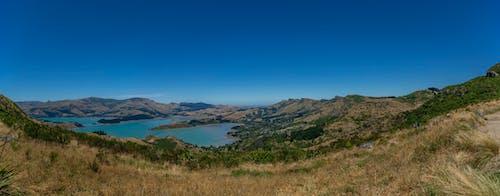 Gratis stockfoto met blauwe lucht, gebied met water, grasland, haven