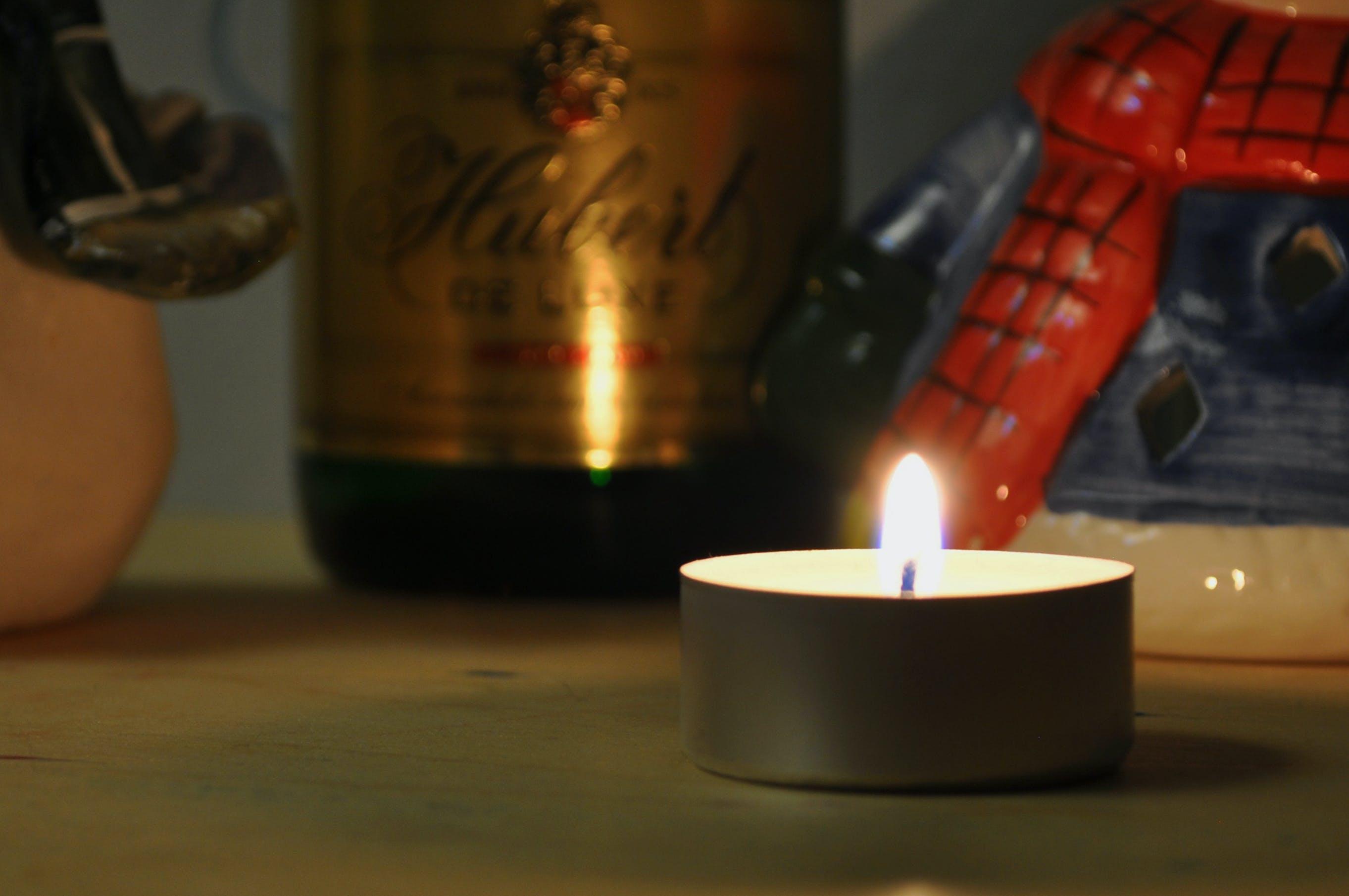 Immagine gratuita di atmosfera, bottiglia, candela, celebrazione