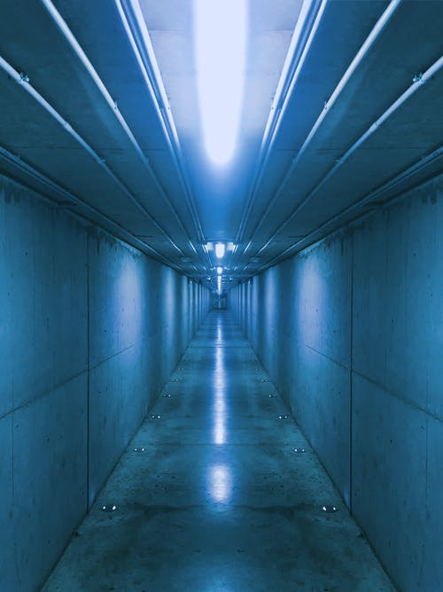 Photo of Empty Well Lit Hallway