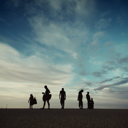 Silhouette Photography of Six Person on Sand Field