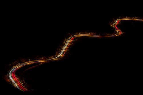 Long Road during Nighttime With Lights