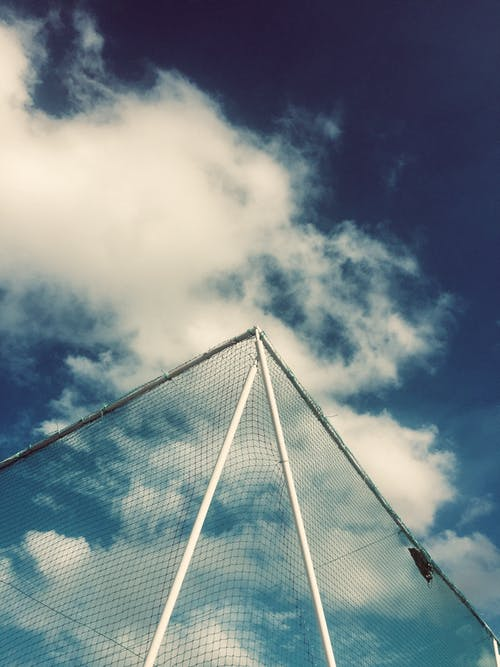 Low Angle View of Net Under Cloudy Sky