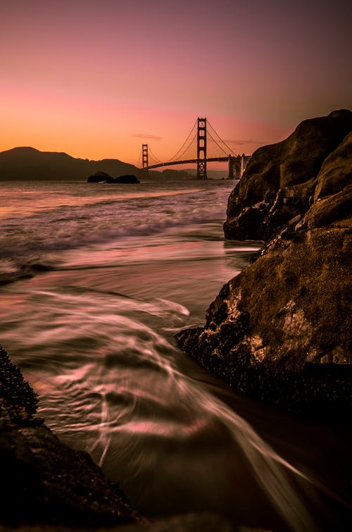 San Francisco Bridge Under Orange Sky at Sunset
