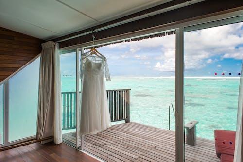 Foto d'estoc gratuïta de a l'aire lliure, aigua, boda a la platja, cel