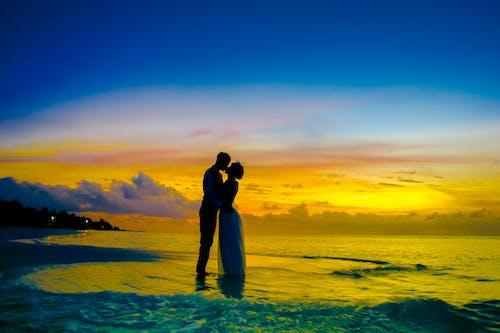 Man and Woman kissing on Seashore