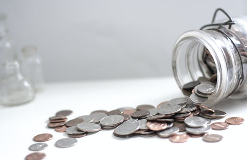 Close-up of Coins on White Background