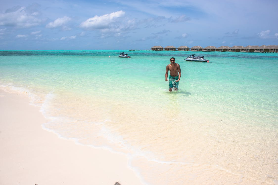 Man Standing on Beach Line