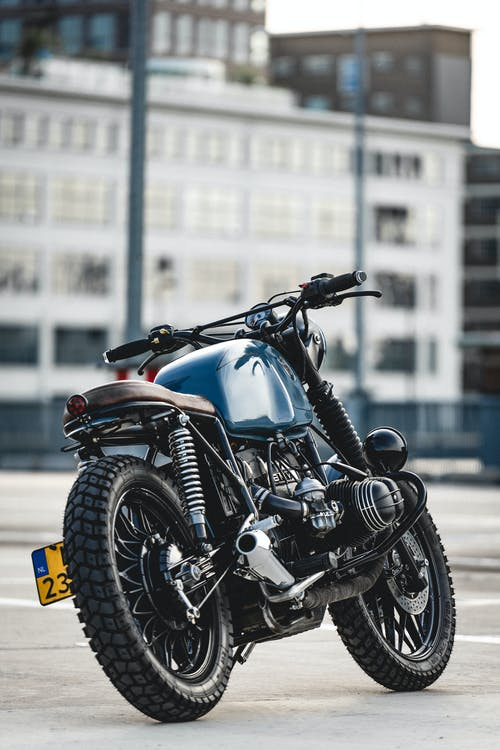 Selective Focus Photo of Parked Blue and Black Cafe Racer Motorcycle