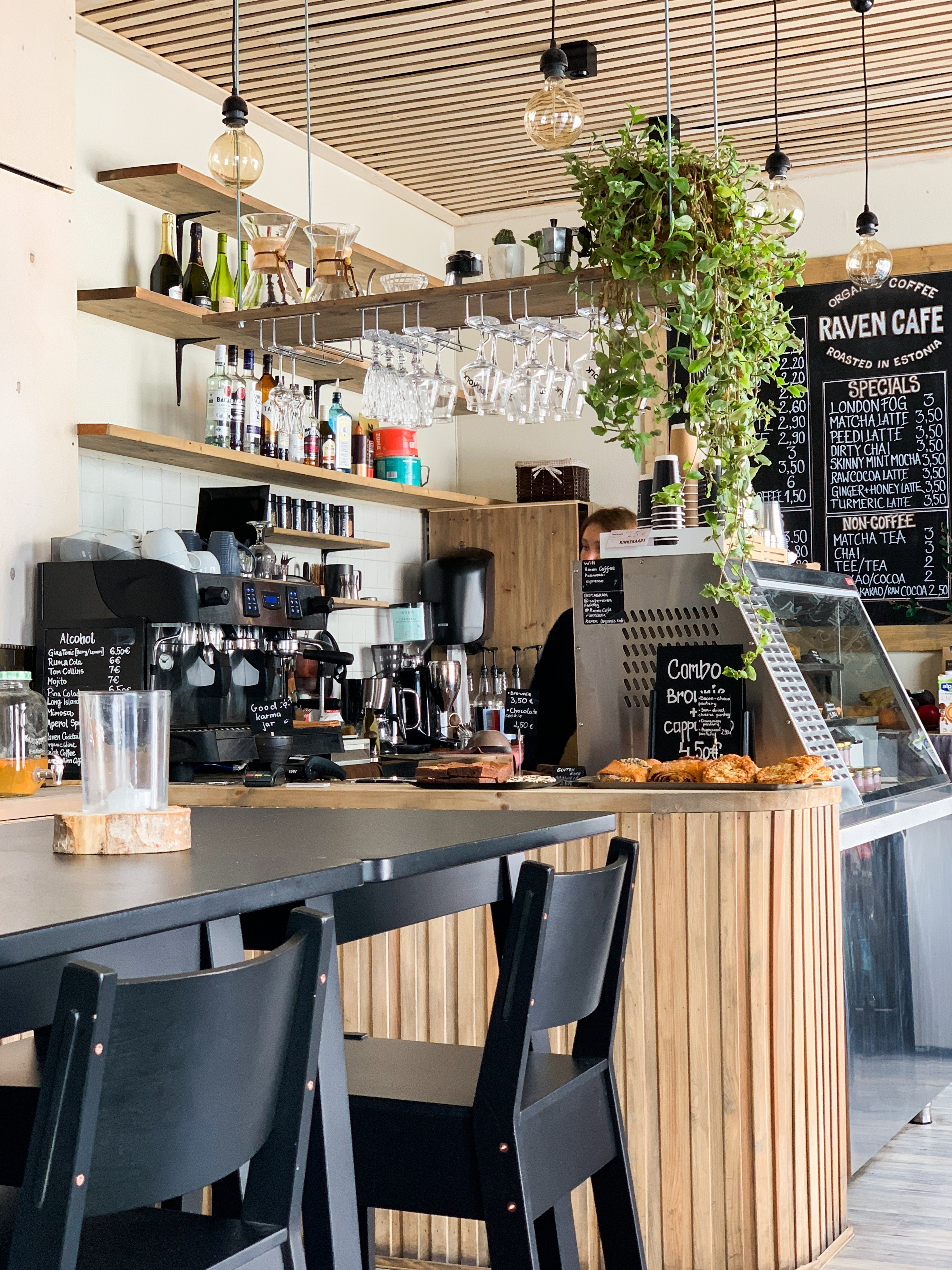 Picture of: Black Wooden Dining Table In A Coffee Shop Free Stock Photo