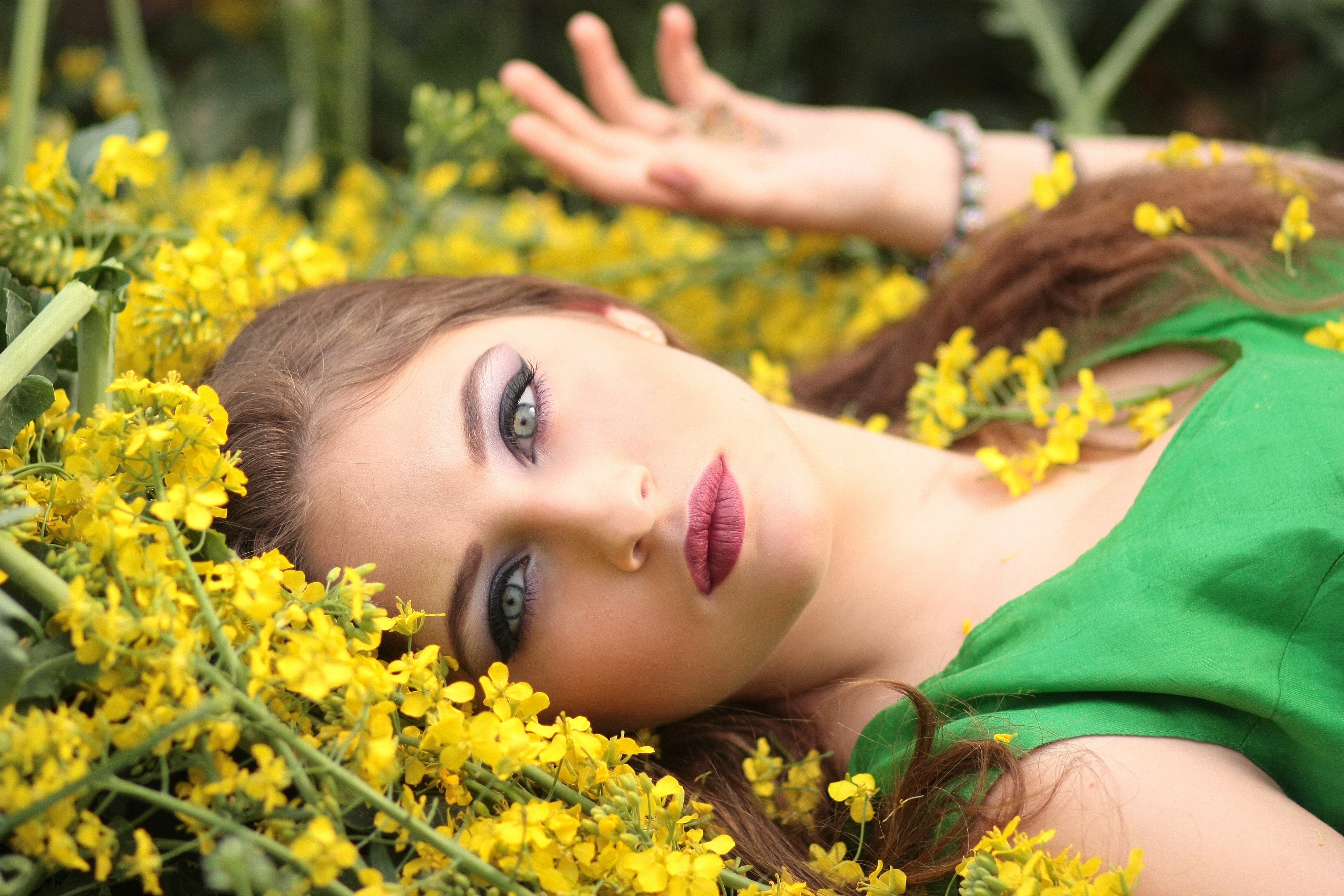 Close up portrait of young woman with yellow flowers free stock photo edit with snappa izmirmasajfo
