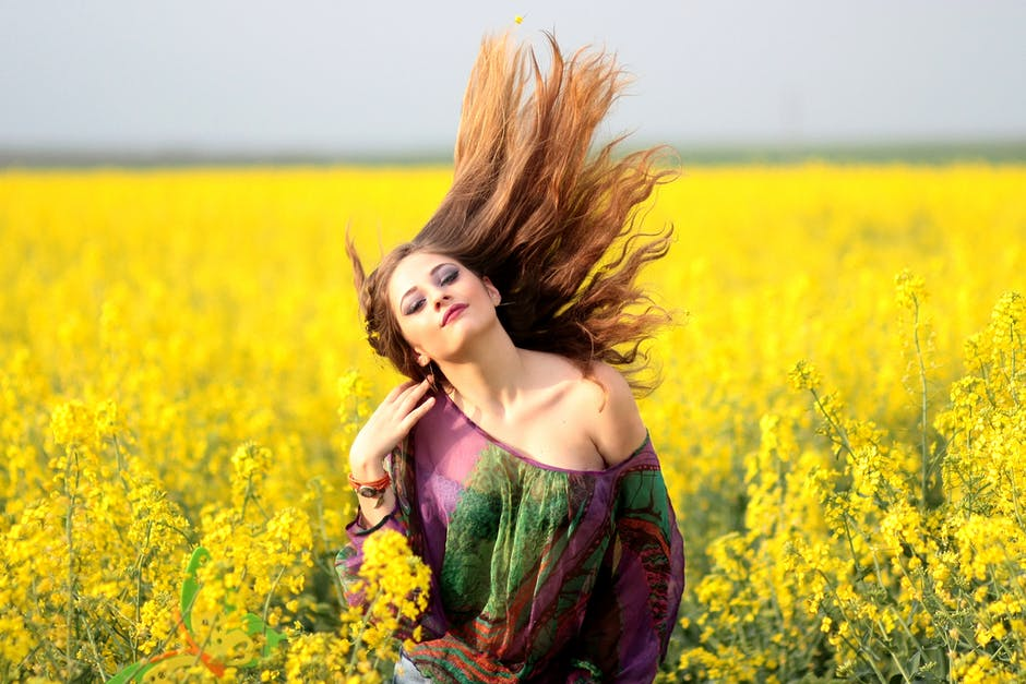 Portrait of young woman with yellow flowers in field free stock photo edit with snappa portrait of young woman with yellow flowers in field mightylinksfo