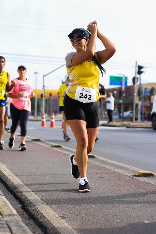 Photo of a woman running in a marathon
