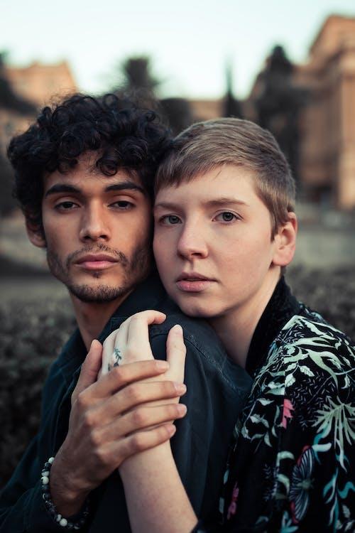 Close-up Portrait Photo of Hugging Couple