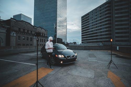 Photos gratuites de centre-ville, homme, individu, véhicule