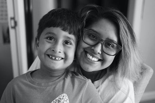 Grayscale Photography of Woman and Boy