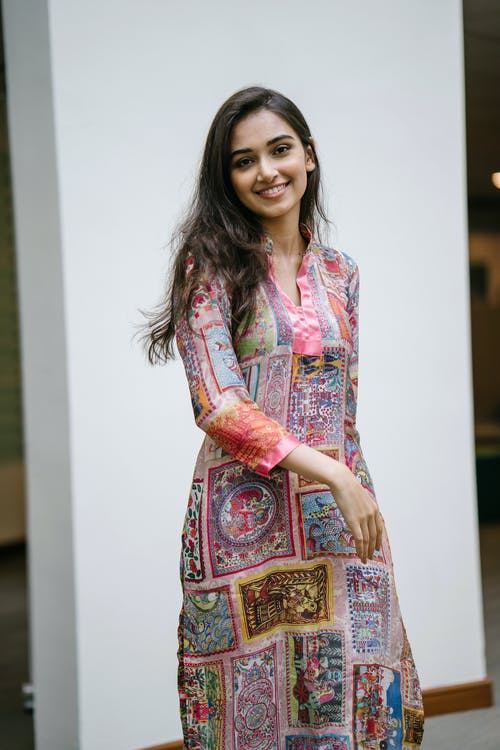 Photo of Smiling Woman in Floral Salwar Kameez Posing