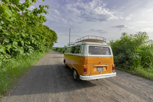 Van Traveling On Road