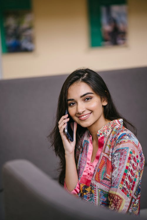Photo of Smiling Woman Talking on Phone