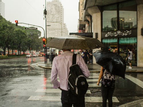 Man Wearing Dress Shirt Holding An Umbrella