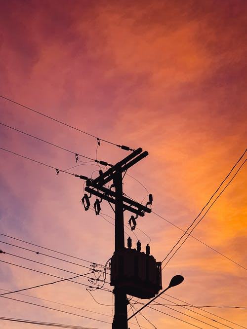Silhouette Of Utility Post